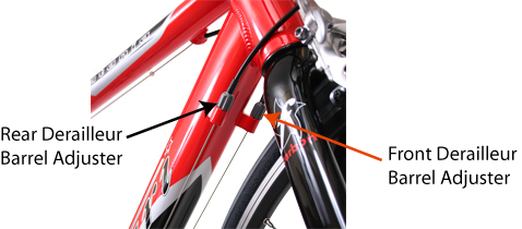 The rear derailleur barrel adjuster is on the right side of the bike.