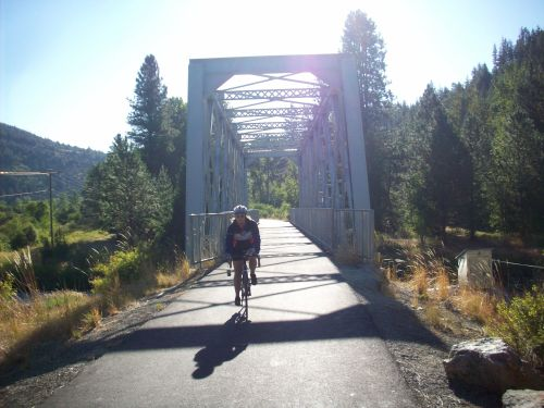 Sunlight reflects off the glassy trail. - Coeur D'Alene Bike Trail