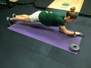 planks with plate 1 - Core Exercises For Cyclists